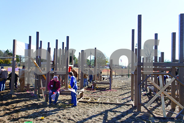 Photo by Shannon Wilson / Tyler Morning Telegraph What looks like just poles sticking out of the ground will be the new Bullard Kids Park.  There are 1,200 volunteers helping to build the park over five days.  The park will be unvailed on Sunday, January 20th at 4:00.