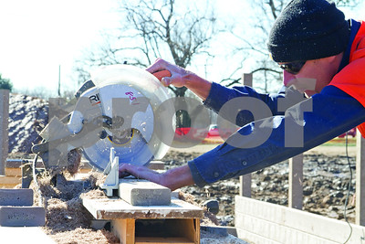 """Photo by Shannon Wilson / Tyler Morning Telegraph Mark White volunteers to help build the new Bullard Kids Park by using a saw to cut the """"wood"""" made out of recycled plasic.  The park will be unvailed on Sunday, January 20th at 4:00."""
