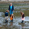 Aaron, Grandma Barrett, Hannah and Kaitlyn explore during a low tide at Alki Beach in West Seattle.
