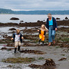 Aaron, Hannah and Grandma Barrett explore during a low tide at Alki Beach in West Seattle.