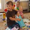 Aaron opening a present.