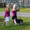 Kaitlyn and Hannah taking Libby for a walk.