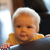 Ava standing next to Dad's chair.