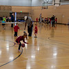 Kaitlyn practicing dribbling a basketball.