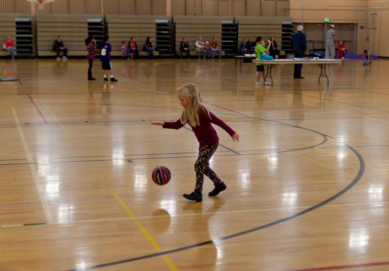 Hannah practicing dribbling a basketball.