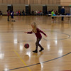 Hannah practicing dribbling a basketball.