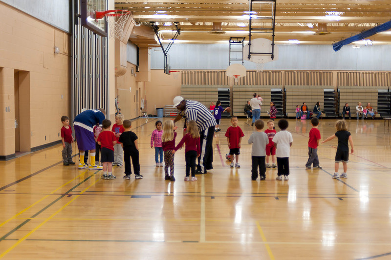 Practicing bounce passes at Basketball class.