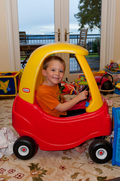 Aaron in Ava's new car.