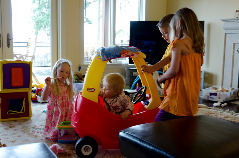 Hannah, Ava, Aaron and Katilyn checking out Ava's new car.