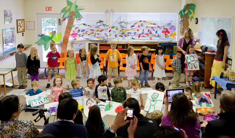 The kids presenting their pictures at the Rainbow Montessori Spring Festival.