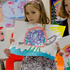 Kaitlyn presenting her picture at the Rainbow Montessori Spring Festival.