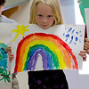 Hannah presenting her picture at the Rainbow Montessori Spring Festival.