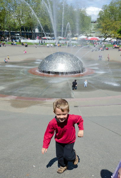 Aaron playing in Seattle Center's International Fountain at the 2011 Northwest Folklife Festival