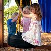 Ava, Hannah and Kaitlyn on their new playset's tire swing.
