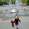 Kaitlyn, Aaron and Hannah playing in Seattle Center's International Fountain at the 2011 Northwest Folklife Festival
