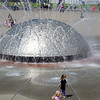 Hannah and Kaitlyn playing in Seattle Center's International Fountain at the 2011 Northwest Folklife Festival