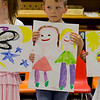 Aaron presenting his picture (of Kaitlyn and Hannah) at the Rainbow Montessori Spring Festival.