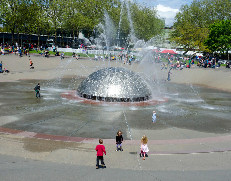 Aaron, Hannah and Kaitlyn playing in Seattle Center's International Fountain at the 2011 Northwest Folklife Festival
