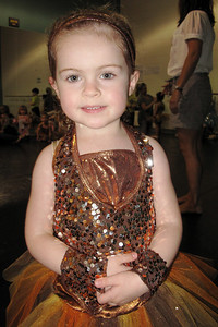 wearing my recital costume and waiting to get our dance group picture taken