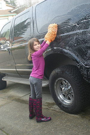 Washing truck for her camp fund.