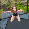 Kaitlyn jumping on the trampoline at her and Hannah's birthday party