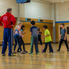 """Hannah and Aaron playing a training game in fencing class.  The class was divided into two teams: foil and epee.  The two teams would stand facing each other with their feet nearly touching.  The teacher would then say either """"Foil"""" or """"Epee"""".  The named team would have to race to the wall behind them without being touched while the other team would try to touch them.  If you were touched you were out of the game."""