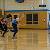 """Hannah playing a training game in fencing class.  The class was divided into two teams: foil and epee.  The two teams would stand facing each other with their feet nearly touching.  The teacher would then say either """"Foil"""" or """"Epee"""".  The named team would have to race to the wall behind them without being touched while the other team would try to touch them.  If you were touched you were out of the game."""
