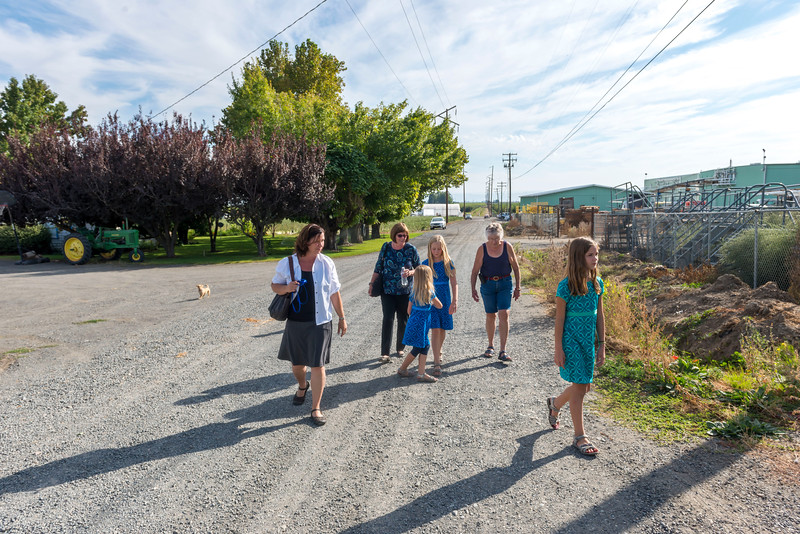 Amanda, Aunt Raylene, Ava, Hannah, Eleanor and Kaitlyn walking down the road from the E.W. Brandt & Sons warehouse towards Lyle's house following the memorial for Everette.   Everette and Lyle are Eleanor's brothers.