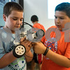 Haedyn Quarles, 9, and Jonathan Taylor, 11, work on their project during a lego robotics summer camp at Discovery Science Place in Tyler, Texas, on Wednesday, June 28, 2017. Students learned teamwork, the basics of coding, as well as design principles for their robots. (Chelsea Purgahn/Tyler Morning Telegraph)