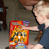 Alex looks at his transformer from GrandDad and Grandma - 6/27