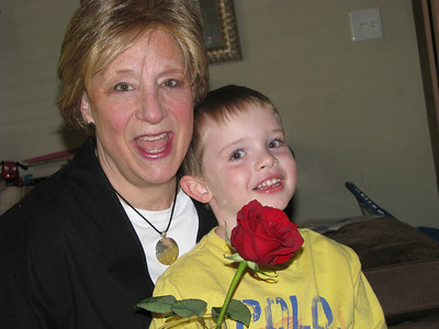 Mimi and Alex with the rose he bought her when he picked her up from the airport