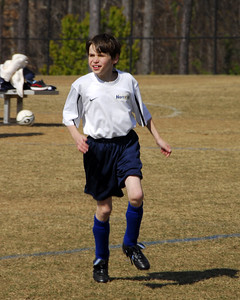 Alex playing soccer