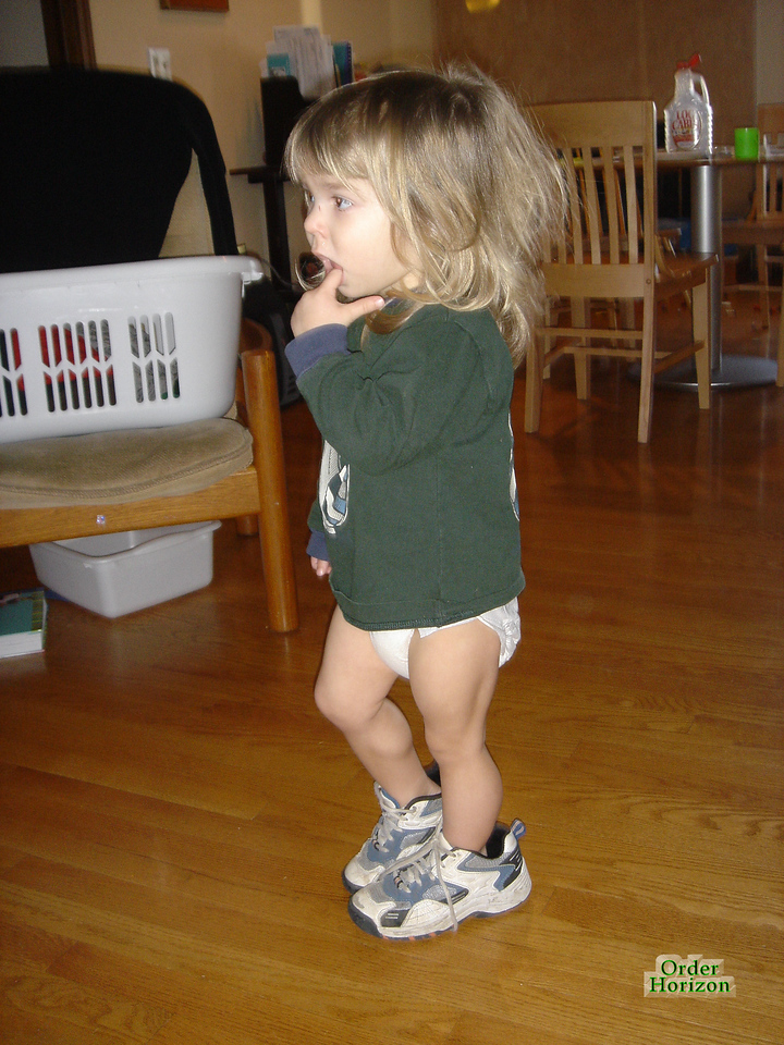 Trying on her brother's shoes