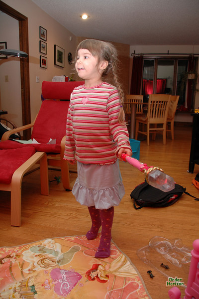 Alice tries out her princess dance DVD and wand