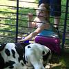 Emma Barrette petting the animals in Ashburnham Sat.