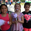 Karina Favreau ,Annabell Oleott and Enelia Robertson enjoying food at downtown day.