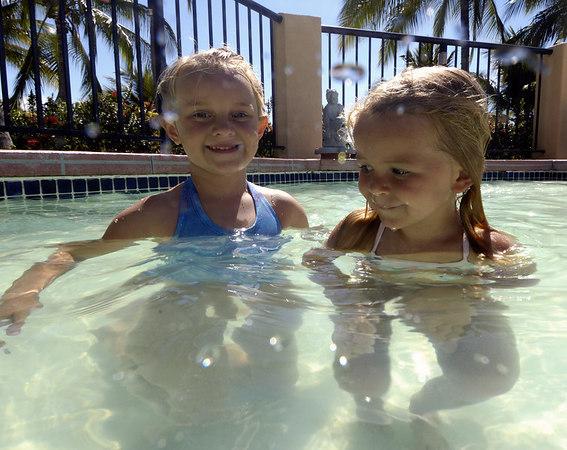 Emily & Emma make friends in the kiddie pool.