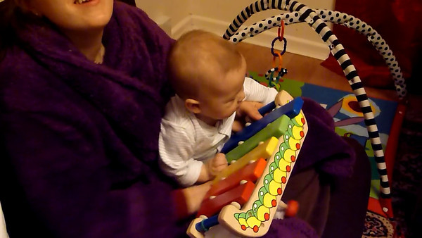 James playing xylophone on Steph's lap 17 Nov 2011