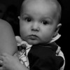 This picture is purely the result of the D200 shutter. The baby was interested in the camera more than the birthday party he was visiting....
