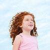 Portrait of young girl with red hair looking up to the sky