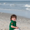 Toddler sitting on the beach in LBI NJ