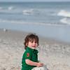 Toddler sitting on the beach in LBI NJ