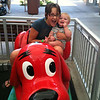 "Zoe and Ben, on Ben's first kiddie ""ride"""