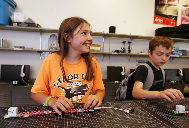 Ally Dinelli and Aiden Mason, both 12 and from Billerica, music synthesizers in the STEAM Center Maker Space at Boys & Girls Club of Greater Billerica. (SUN/Julia Malakie)