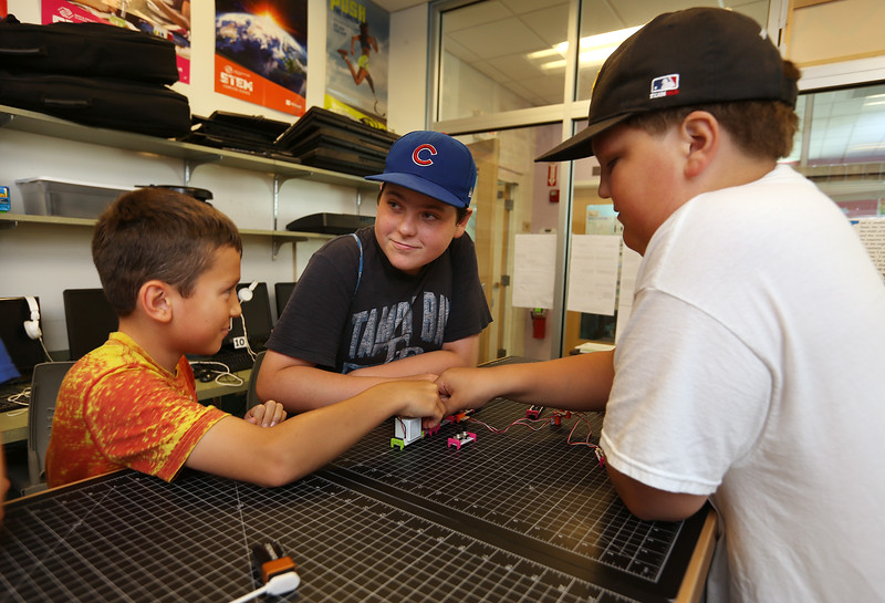 From left, Anthony Massaro, 12, Jacob Wahbeh, 13, and Christian Young, 12, all of Billerica, make music synthesizers in the STEAM Center Maker Space at Boys & Girls Club of Greater Billerica. (SUN/Julia Malakie)