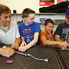 From left, Michael Smith, 11, Brandon Harmon [forgot to get age], Anthony Massaro, 12, and Jacob Wahbeh, 13, all of Billerica, make music synthesizers in the STEAM Center Maker Space at Boys & Girls Club of Greater Billerica. (SUN/Julia Malakie)