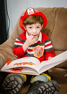 noah with his book