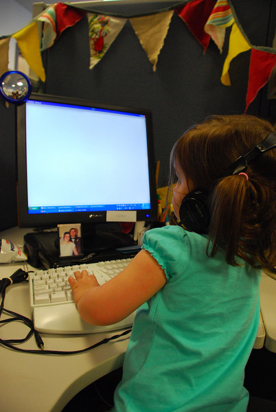 Catherine hard at work, coding in Notepad.