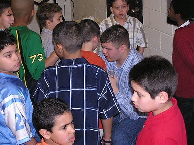 Isaiah Ministering to Boys during Altar Call at Kid'z C.L.U.B.