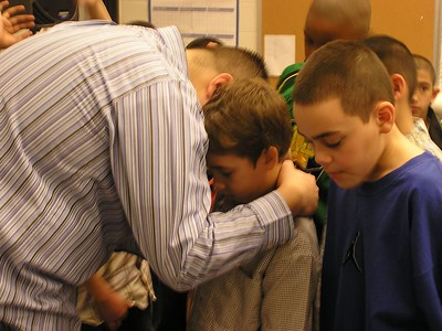 Isaiah Praying for Boy during Altar Call at Kid'z C.L.U.B.